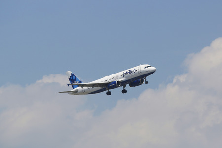 NEW YORK - JULY 8 JetBlue Airbus A320 in New York sky before landing at JFK Airport on July 8, 2014  JetBlue Airways is an American low-cost airline with main base at JFK International Airport