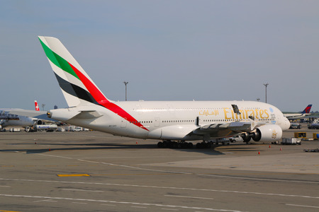 world   s largest: NEW YORK -JULY 10  Emirates Airline Airbus A380 at JFK Airport  in New York on July 10, 2014  The Airbus A380 is a double-deck, wide-body, world s largest passenger airliner  Editorial