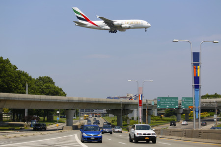 world's: NEW YORK -JULY 8  Emirates Airline Airbus A380 on approach to JFK International Airport in New York on July 8, 2014   The Airbus A380 is a double-deck, wide-body, world s largest passenger airliner