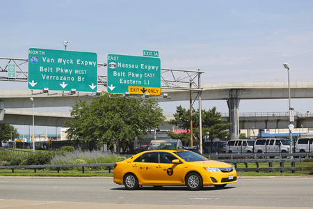 NEW YORK - JULY 10  New York Taxi at Van Wyck Expressway entering JFK International Airport in New York on July 10, 2014  JFK is the busiest international air passenger gateway in the United States