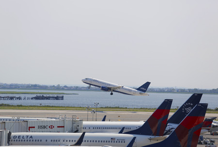 runways: NEW YORK - JULY 10  JetBlue  Airbus A320 taking off from JFK Airport in New York on July 10, 2014  JFK Airport is one of the biggest and most busy airports in the world with 4 runways and 8 terminals