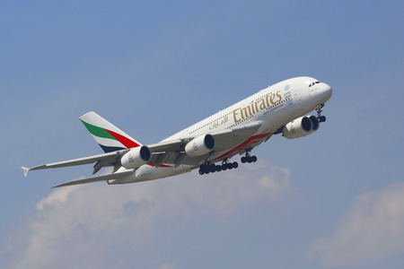 world   s largest: NEW YORK -JULY 8  Emirates Airline Airbus A380 in New York sky before landing at JFK Airport on July 8, 2014  The Airbus A380 is a double-deck, wide-body, world s largest passenger airliner