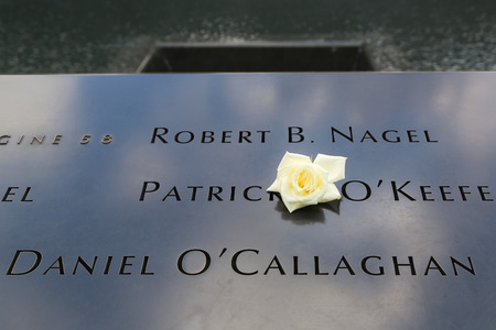 9 11: NEW YORK  - JULY 17, 2014  Flower left at the National 9 11 Memorial at Ground Zero in Lower Manhattan on July 17, 2014 Editorial