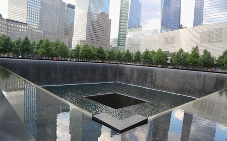 NEW YORK - JULY 17, 2014  Waterfall in September 11 Memorial Park on July 17, 2014 City  Two pools with the largest manmade waterfalls in the USA  are located within the footprints of the Twin Towers