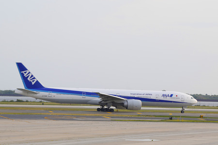 runways: NEW YORK - JULY 10  All Nippon Airways Boeing 777 taxing in JFK Airport in NY on July 10, 2014  JFK Airport is one of the biggest and most busy airports in the world with 4 runways and 8 terminals
