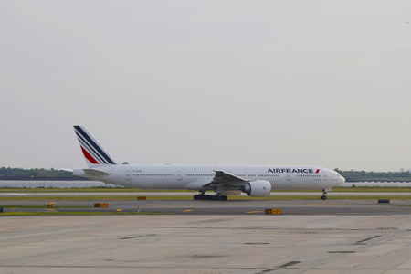 runways: NEW YORK - JULY 10  AirFrance Boeing 777 taxing in JFK Airport in NY on July 10, 2014  JFK Airport is one of the biggest and most busy airports in the world with 4 runways and 8 terminals