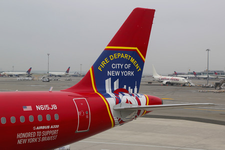 jetblue: NEW YORK- JUNE 10  JetBlue Airbus A320 Honoring the brave men and women Fire Department City of NY tailfin at John F Kennedy International Airport in New York on June 10, 2014