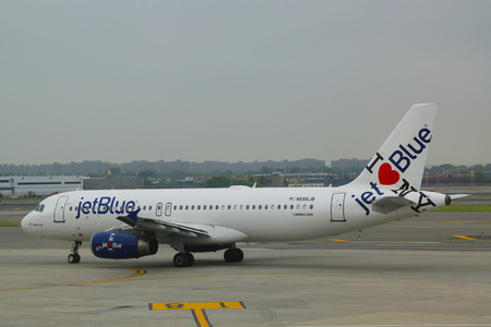 hometown: NEW YORK- JUNE 10  JetBlue Airbus A320 with NY s hometown airline tailfin design taxing at John F Kennedy International Airport in New York on June 10, 2014