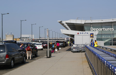 runways: NEW YORK- JULY 22  Delta Airline Terminal 4 at John F Kennedy International Airport in New York on July 22, 2014  JFK is one of the biggest airports in the world with 4 runways and 8 terminals Editorial