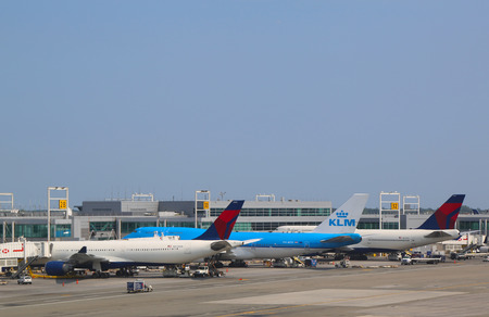 kennedy: NEW YORK- JULY 22   KLM Boeing 747, Delta Airline Boeing 747 and Airbus A330 at the gates at the Terminal 4 at John F Kennedy International Airport in New York on July 22, 2014