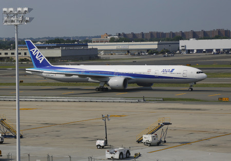 runways: NEW YORK - JULY 22  All Nippon Airways Boeing 777 taxing in JFK Airport in NY on July 22, 2014  JFK Airport is one of the biggest and most busy airports in the world with 4 runways and 8 terminals Editorial