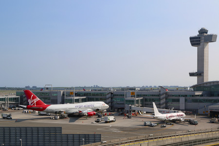 kennedy: NEW YORK - JULY 22  Air Traffic Control Tower and Terminal 4 with Virgin Atlantic Boeing 747 and Caribbean Airlines Boeing 737 at the gates in JFK Airport in NY on July 22, 2014