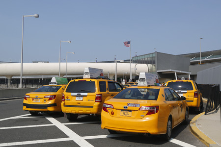 jetblue: NEW YORK- JULY 22  New York Taxi line next to JetBlue Terminal 5 at John F Kennedy International Airport in New York on July 22, 2014