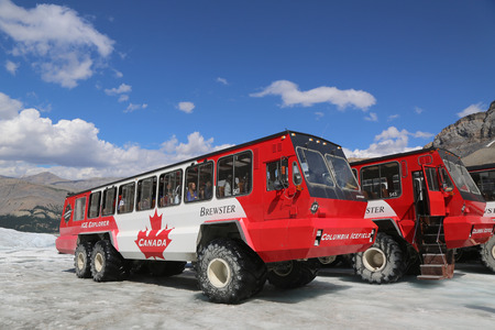 icefield: ALBERTA, CANADA- JULY 27  Massive Ice Explorers, specially designed for glacial travel, take tourists onto the surface of the Athabasca Glacier  on July 27, 2014 in the Columbia Icefields, Canada   Editorial