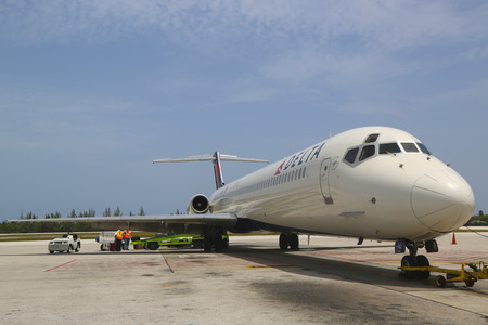 roberts: GRAND CAYMAN, CAYMAN ISLANDS - June 13  Delta Airlines McDonnell Douglas MD-80  at Owen Roberts International Airport at Grand Cayman on June 13, 2014