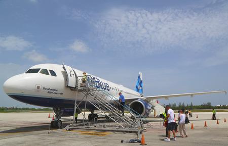 jetblue: GRAND CAYMAN, CAYMAN ISLANDS - June 13  JetBlue Airbus A320 at Owen Roberts International Airport at Grand Cayman on June 13, 2014