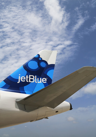 cayman islands: GRAND CAYMAN, CAYMAN ISLANDS - June 13  JetBlue Airbus A320 blueberries-inspired design tailfin  at Owen Roberts International Airport at Grand Cayman on June 13, 2014 Editorial
