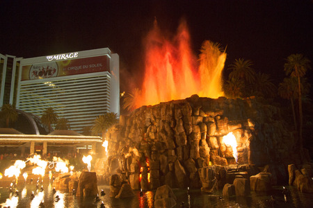 a mirage: LAS VEGAS, NEVADA - MAY 12   The Mirage Hotel artificial Volcano Eruption show in Las Vegas on May 12, 2014, The Mirage hotel opened in 1989 and it has 100,000 square feet of gaming space Editorial