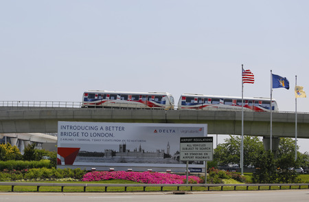 miles: NEW YORK - JULY 8  JFK Airport AirTrain in New York on July 8, 2014  AirTrain JFK is a 3-line, 8 1 miles long elevated railway providing service to Kennedy International Airport