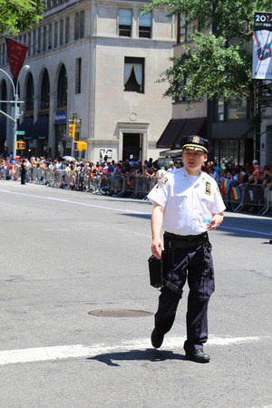 sexual orientation: NEW YORK - June 29  NYPD officer providing security during  LGBT Pride Parade  in NY on June 29, 2014  LGBT pride march takes place during pride week and is the culmination of week long festivities