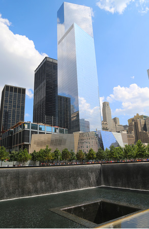 NEW YORK - AUGUST 7  World Trade Center 4, September 11 Museum and Reflection Pool with Waterfall in September 11 Memorial Park on August 7, 2014
