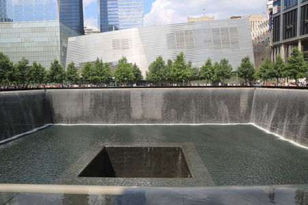 NEW YORK - AUGUST 7  Waterfall in September 11 Memorial Park on August 7, 2014 City  Two pools with the largest manmade waterfalls in the USA are located within the footprints of the Twin Towers
