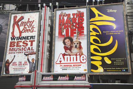 annie: NEW YORK  - JANUARY 26  Broadway signs in Manhattan on January 26, 2014  With over 40 prominent theater houses, Broadway theater is considered one of the world s highest levels of commercial theater