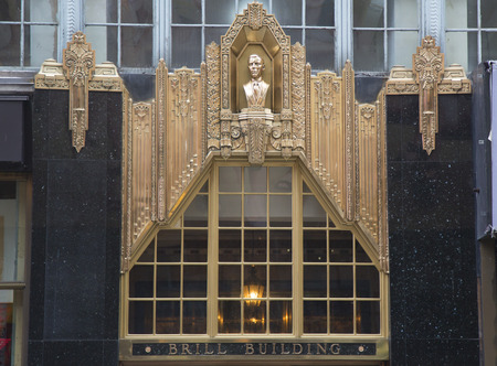 american music: NEW YORK - JANUARY 26  Facade at the Brill Building in Manhattan on January 26, 2014   It is famous for housing music industry studios where some of the most popular American music tunes were written Editorial