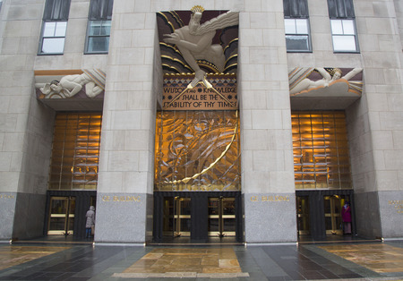 general knowledge: NEW YORK CITY - JANUARY 26  Wisdom, an art deco frieze by Lee Lawrie over the entrance of GE Building at Rockefeller plaza on January 26, 2014