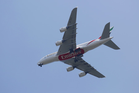 world's: NEW YORK - AUGUST 10  Emirates Airline Airbus A380 in New York sky before landing at JFK Airport on August 10, 2014  The Airbus A380 is a double-deck, wide-body, world s largest passenger airliner