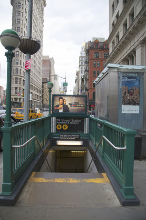 subway entrance: NEW YORK - APRIL 27  Subway entrance at 23rd Street in NYC on April 27, 2014  Station has free Wi-Fi available  Owned by the NYC Transit Authority, the subway system has 469 stations in operation