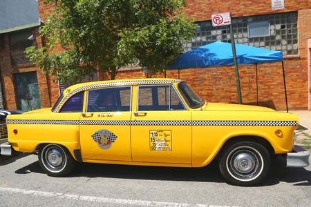 checker: BROOKLYN, NY -JUNE 21  Checker Marathon taxi car produced by the Checker Motors Corporation in Brooklyn on June 21, 2014  The Checker remains the most famous taxi cab vehicle in the United States