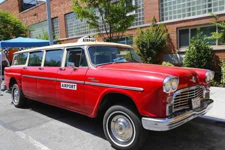 checker: BROOKLYN, NY -JUNE 21  1967 Checker Aerobus A12 car produced by the Checker Motors Corporation in Brooklyn on June 21, 2014  The Checker remains the most famous taxi cab vehicle in the United States