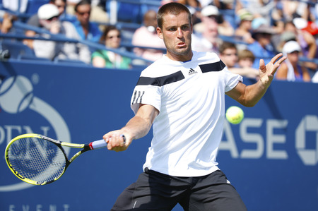 mikhail: NEW YORK- SEPTEMBER 3  Professional tennis player Mikhail Youzhny during fourth round match at US Open 2013 against Lleyton Hewitt at Billie Jean King National Tennis Center on September 3, 2013 in New York