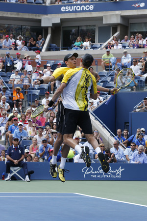 atp: NEW YORK - SEPTEMBER 1  Grand Slam champions Mike and Bob Bryan during third round doubles match at US Open 2013 against Daniel Nestor and Vasek Pospisilr on September 1, 2013 in New York
