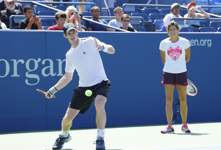 backhand: NEW YORK - AUGUST 19  Grand Slam Champion Andy Murray practices with his coach Amelie Mauresmo for US Open 2014 at Billie Jean King National Tennis Center on August 19 , 2014 in New York  Editorial