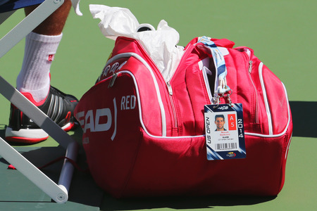 NEW YORK - AUGUST 24 Six times Grand Slam champion Novak Djokovic customized Head tennis bag at US Open 2014 at Billie Jean King National Tennis Center on August 24, 2014 in New York Editorial