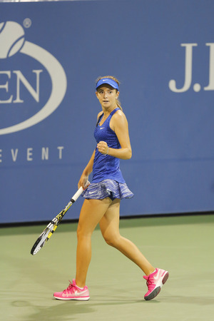diyas: NEW YORK - AUGUST 28 Fifteen years old tennis player Catherine Bellis during second round match at US Open 2014 against Zarina Diyas on August 28, 2014 in New York