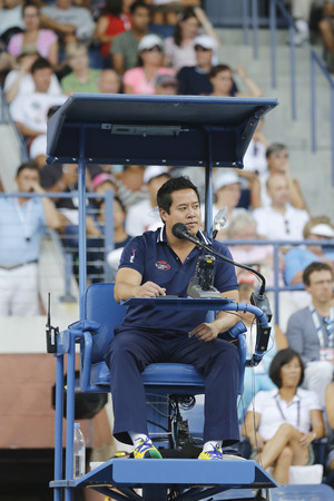 king chair: NEW YORK - AUGUST 26 Chair umpire James Keothavong during first round match between Gael Monfis and Jared Donaldson at US Open 2014 at Billie Jean King National Tennis Center on August 26, 2014 in NY