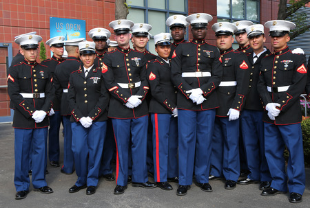 unfurling: NEW YORK- SEPTEMBER 7  United States Marines at Billie Jean King National Tennis Center before unfurling the American flag prior US Open 2014 women final on September 7, 2014 in New York