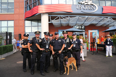 k 9: NEW YORK - SEPTEMBER 7: NYPD transit bureau K-9 police officers and K-9 dog providing security at National Tennis Center during US Open 2014 on September 7, 2014 in New York