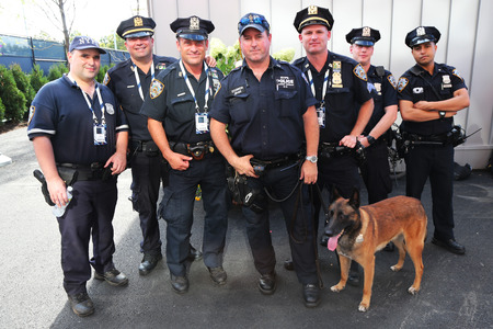 NEW YORK - SEPTEMBER 7: NYPD transit bureau K-9 police officers and K-9 dog providing security at National Tennis Center during US Open 2014 on September 7, 2014 in New York