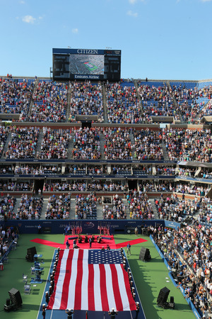 unfurling: NEW YORK- SEPTEMBER 7  US Marine Corps unfurling American Flag  during the opening ceremony of the US Open 2014 women final at Billie Jean King National Tennis Center on September 7, 2014 in New York