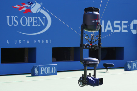 NEW YORK - AUGUST 25: Spidercam aerial camera system used for broadcast from Arthur Ashe Stadium at the Billie Jean King National Tennis Center during US Open 2014 on August 25, 2014 in New York