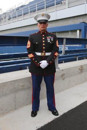 u.s. flag: NEW YORK- SEPTEMBER 8  United States Marine officer at Billie Jean King National Tennis Center before unfurling the American flag prior US Open 2014 men final on September 8, 2014 in New York