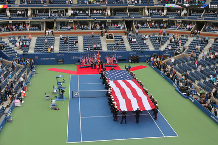 u.s. flag: NEW YORK- SEPTEMBER 8  US Marine Corps unfurling American Flag  during the opening ceremony of the US Open 2014 men final at Billie Jean King National Tennis Center on September 8, 2014 in New York