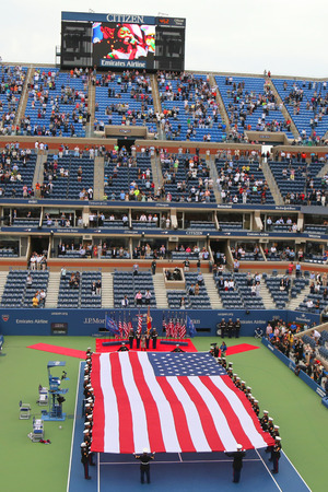 unfurling: NEW YORK- SEPTEMBER 8  US Marine Corps unfurling American Flag  during the opening ceremony of the US Open 2014 men final at Billie Jean King National Tennis Center on September 8, 2014 in New York