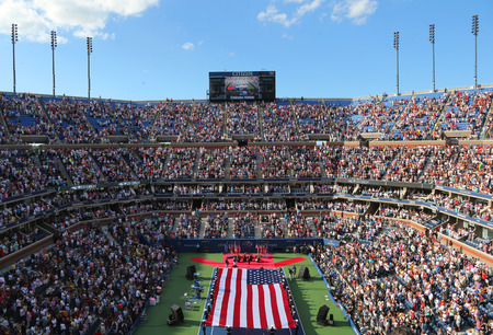 u.s. flag: NEW YORK- SEPTEMBER 7  US Marine Corps unfurling American Flag  during the opening ceremony of the US Open 2014 women final at Billie Jean King National Tennis Center on September 7, 2014 in New York