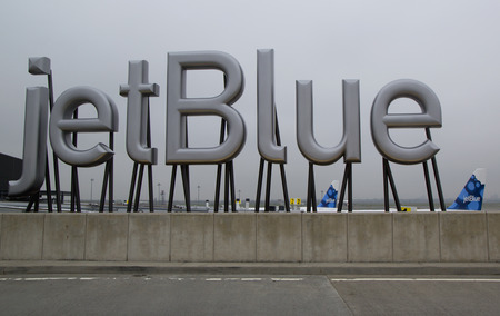 jetblue: NEW YORK- MAY 8: JetBlue sign at the Terminal 5 at John F Kennedy International Airport in New York on May 8, 2014. JFK is one of the biggest airports in the world with 4 runways and 8 terminals