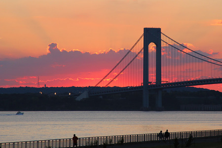 boroughs: NEW YORK - SEPTEMBER 18:Verrazano Bridge at sunset in New York on September 18, 2014.The Verrazano Bridge is a double-decked suspension bridge that connects the boroughs of Staten Island and Brooklyn